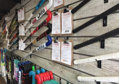Field Hockey Stick Wall with Product Information